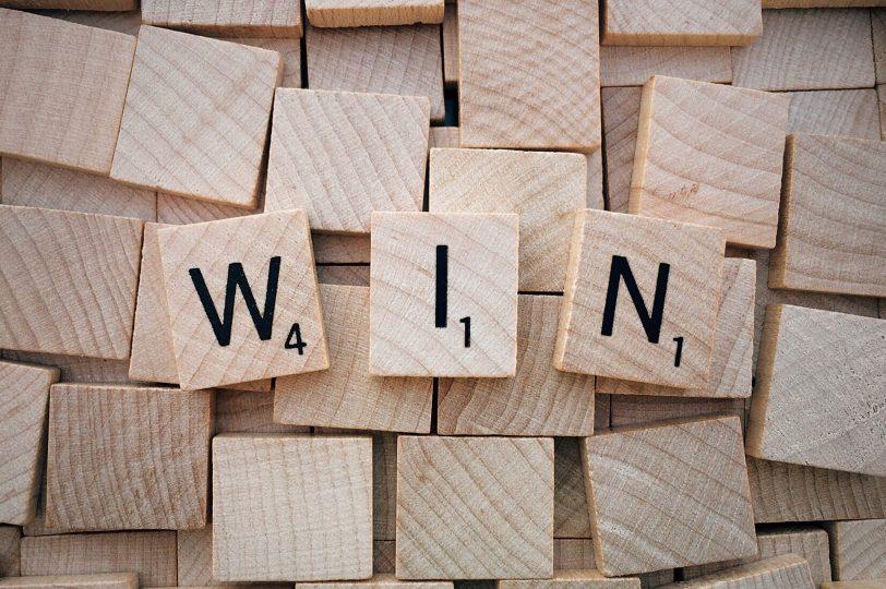 Scrabble tiles spelling WIN