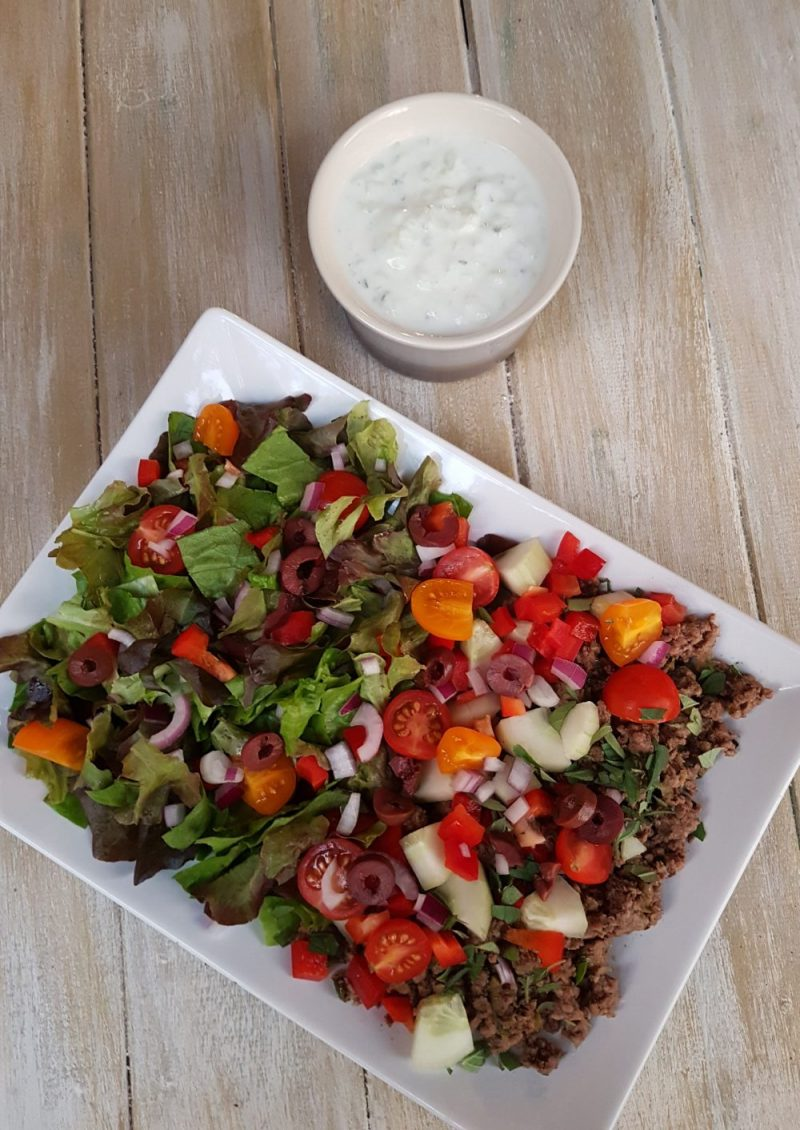 Greek beef salad with tzatziki dressing for a healthy lunch or dinner