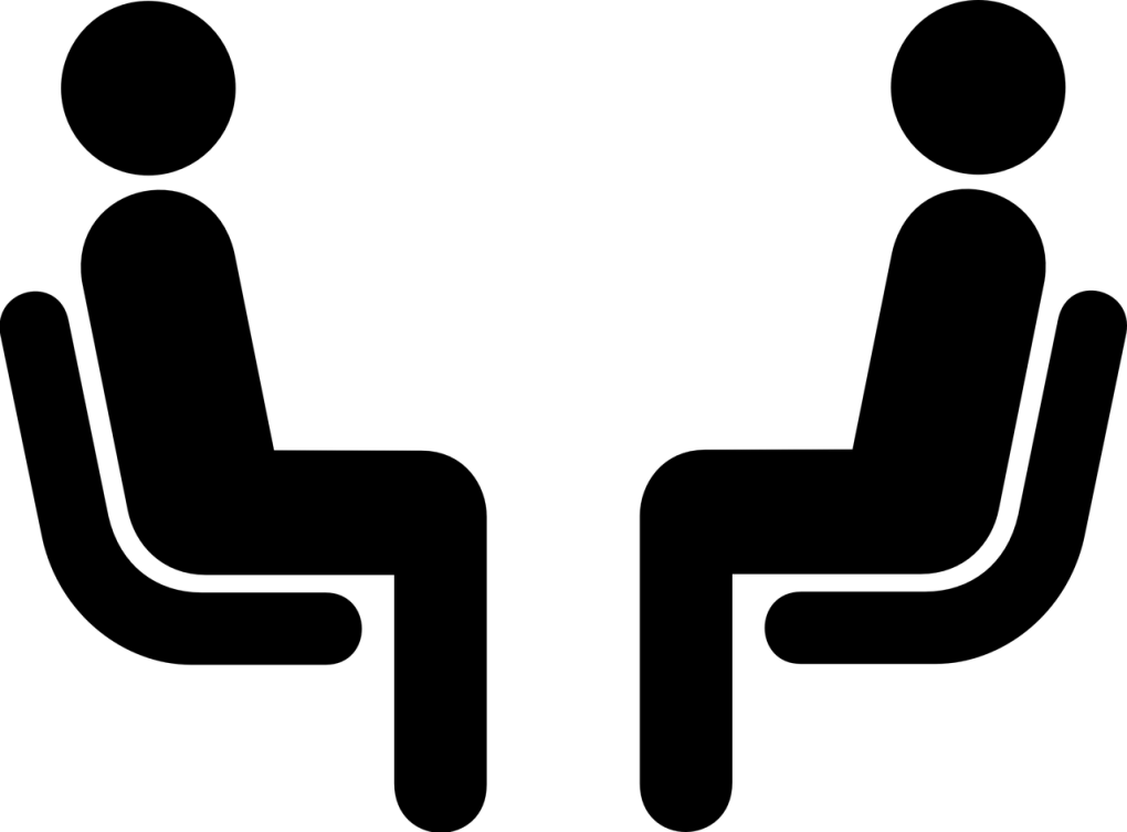 Cartoon of two people sitting down having a conversation
