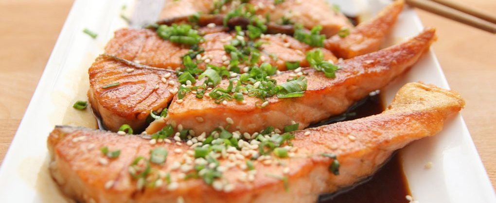 Keto diet meal of salmon and green onions